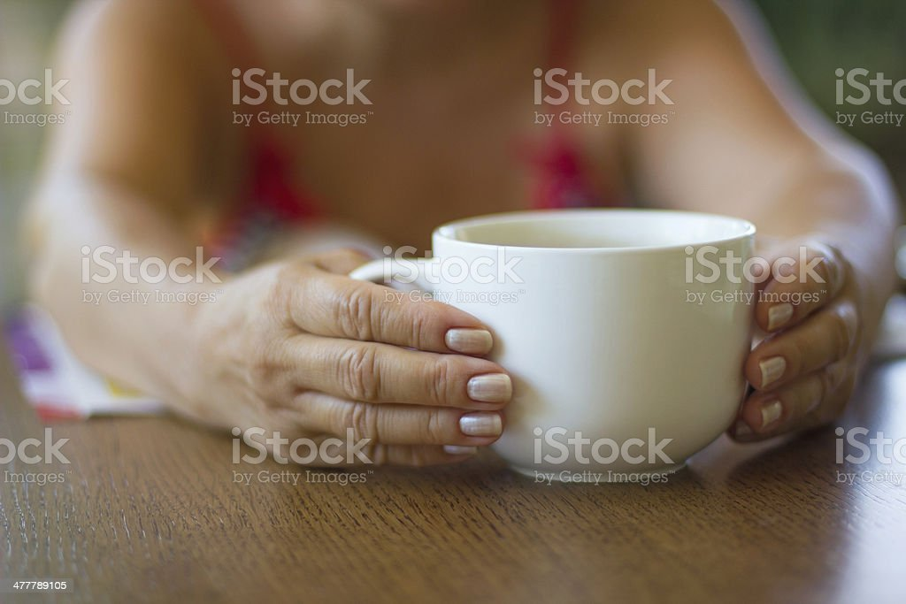 Hands holding coffee cup royalty-free stock photo
