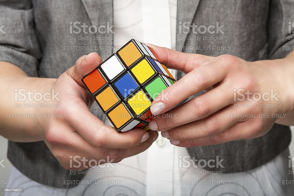 Hands holding color cube stock photo