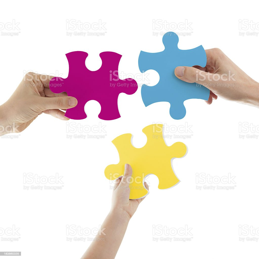Hands Holding Colored Puzzle Pieces royalty-free stock photo