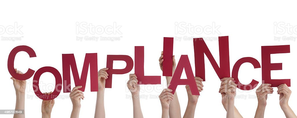 Hands Holding Compliance stock photo