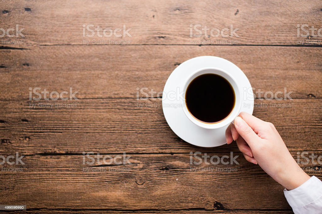 Hands holding cup of coffee stock photo