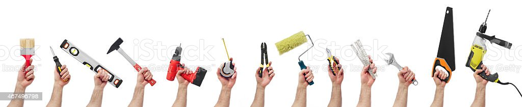 13 hands holding different types of tools stock photo