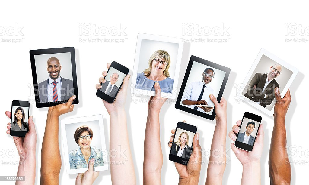 Hands Holding Digital Devices with Business People stock photo