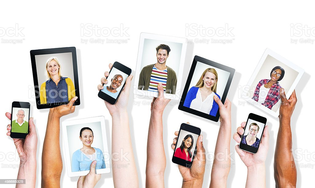 Hands Holding Digital Devices with People's Images stock photo