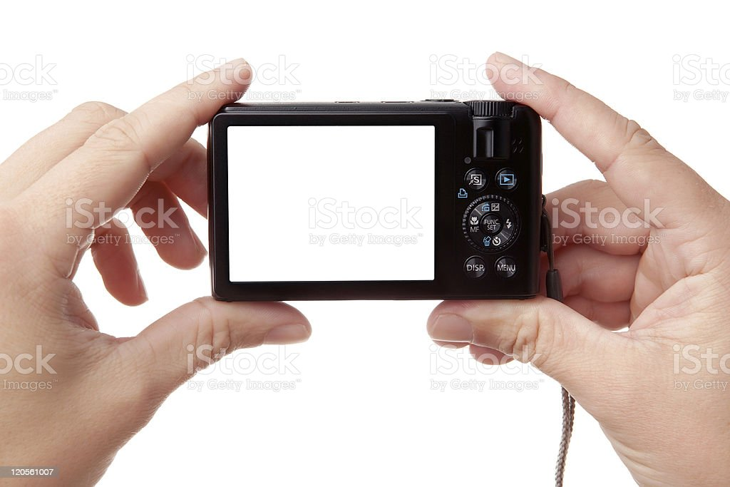 Hands holding digital photo camera royalty-free stock photo