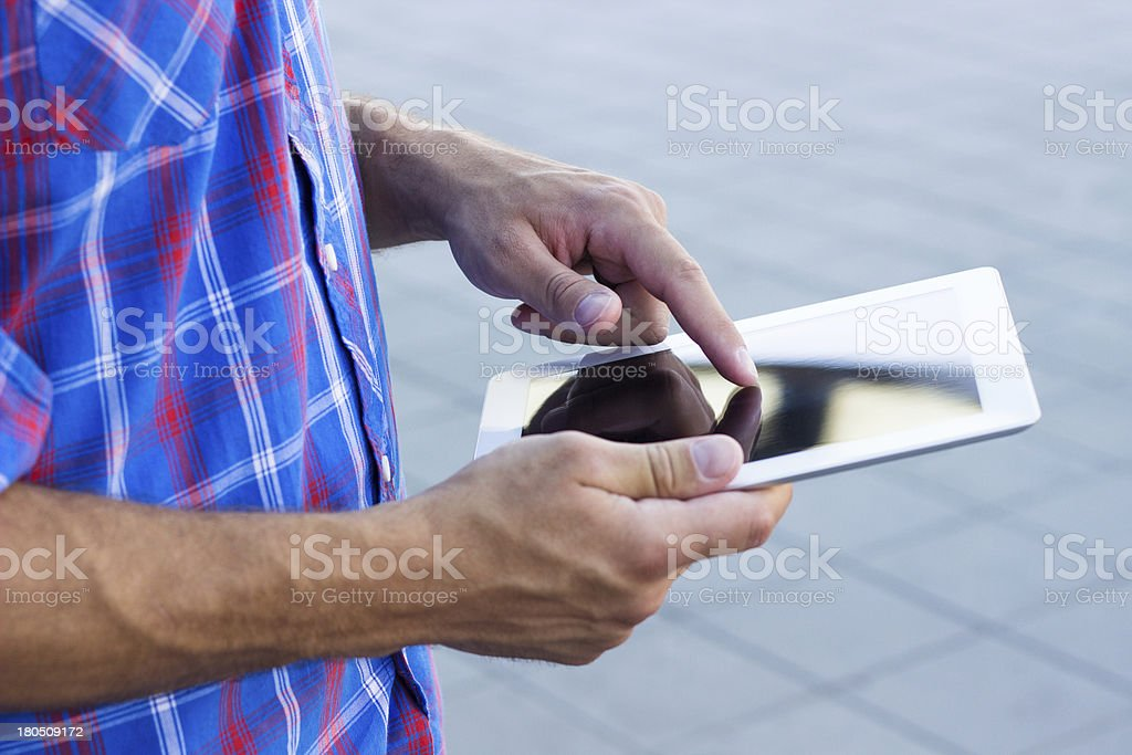 Hands holding digital tablet royalty-free stock photo