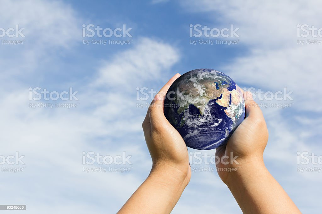 hands holding earth. Elements of this image furnished by NASA stock photo
