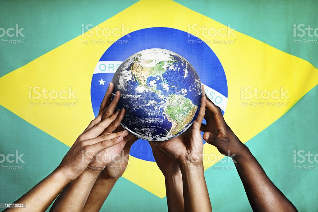 Hands holding Earth image against Brazilian flag: world championship time! royalty-free stock photo