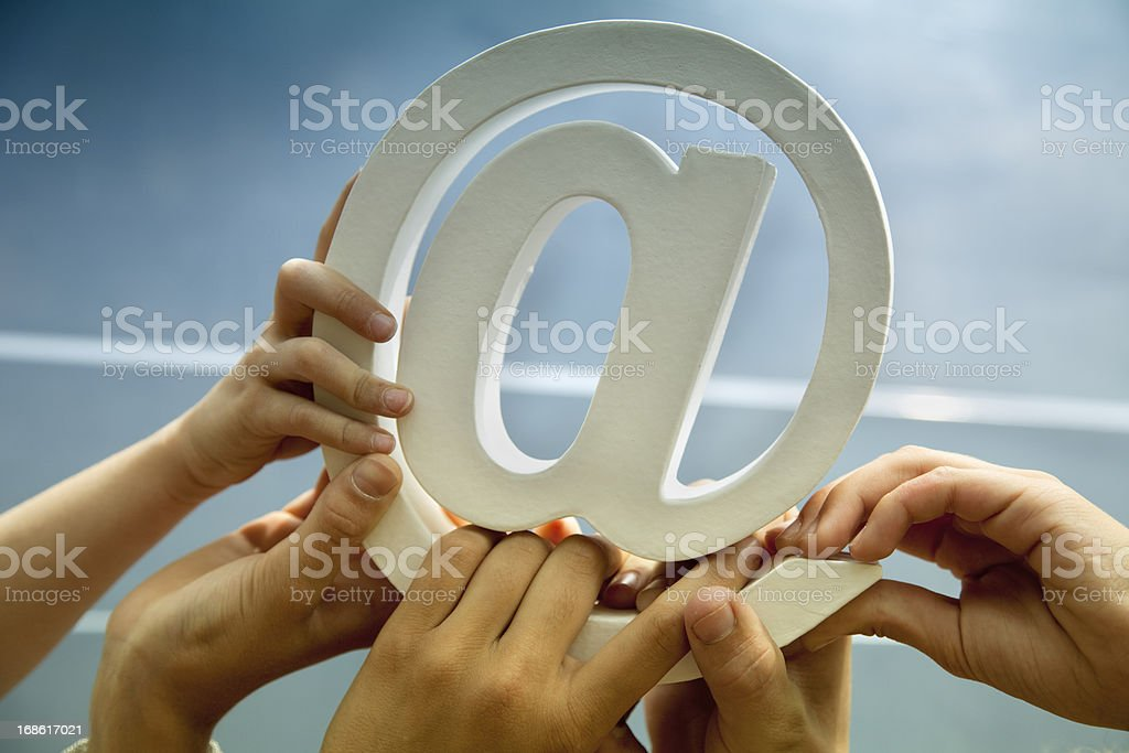 hands holding email symbol stock photo