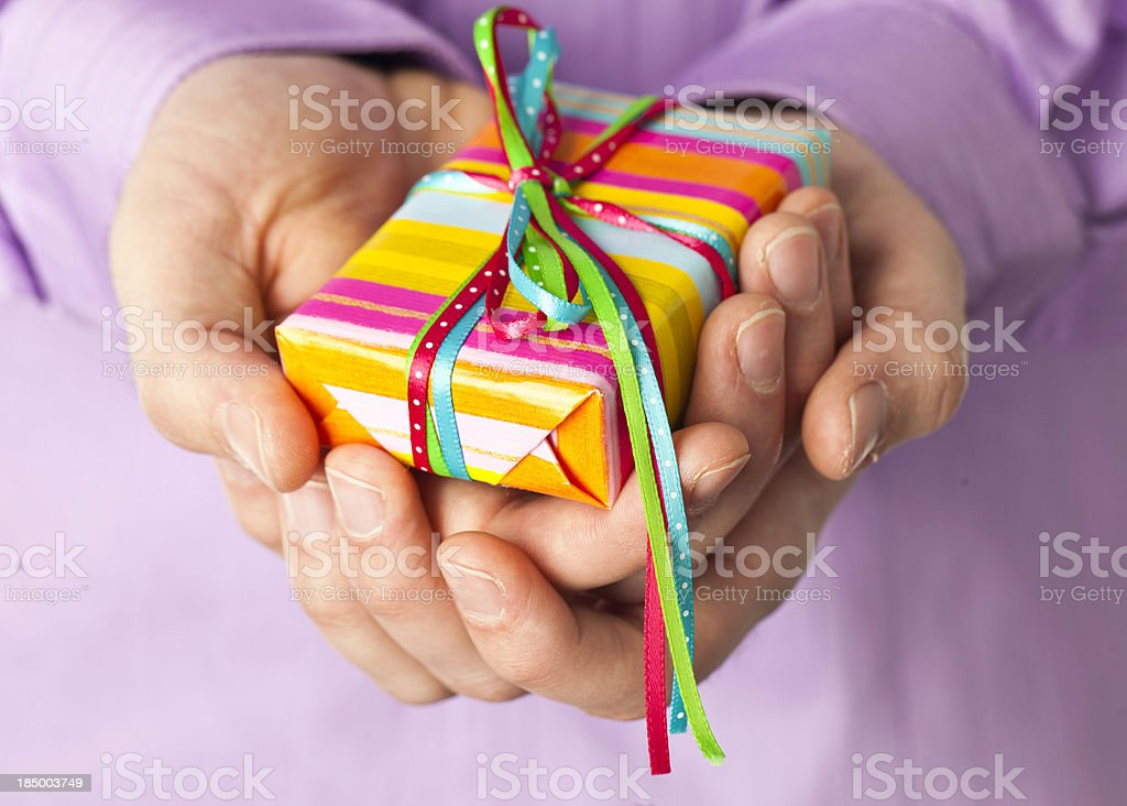 Hands Holding Gift royalty-free stock photo