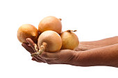 Hands holding gold onions