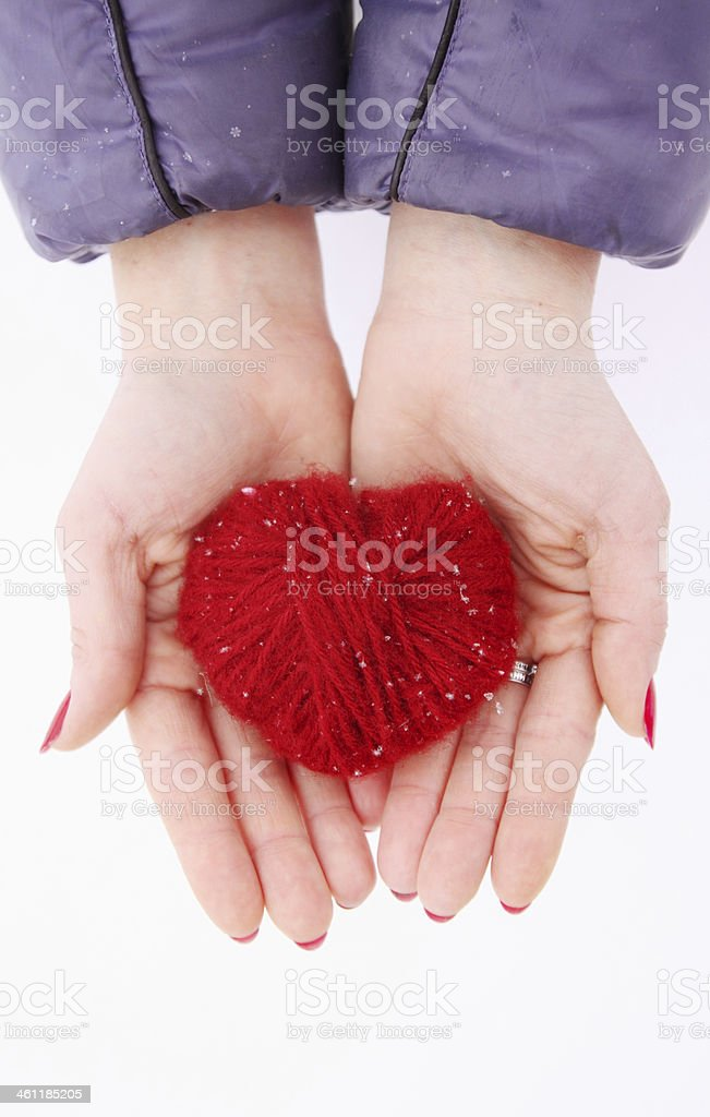 hands holding heart stock photo