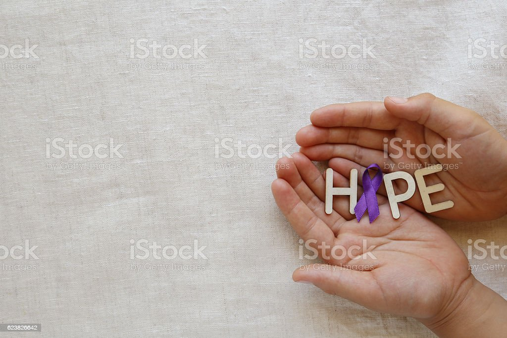 Hands holding HOPE with Purple ribbon, copy space background, Al stock photo