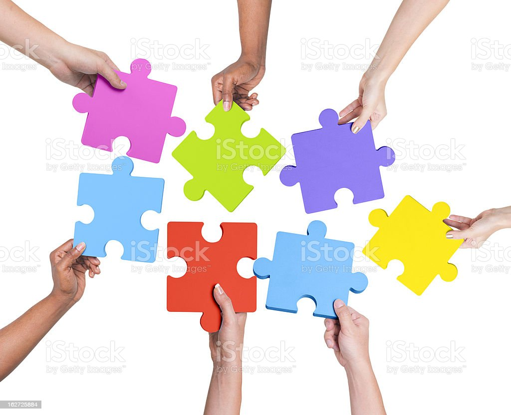 Hands Holding Jigsaw royalty-free stock photo