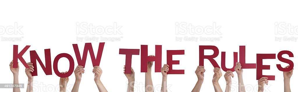 Hands Holding Know the Rules stock photo