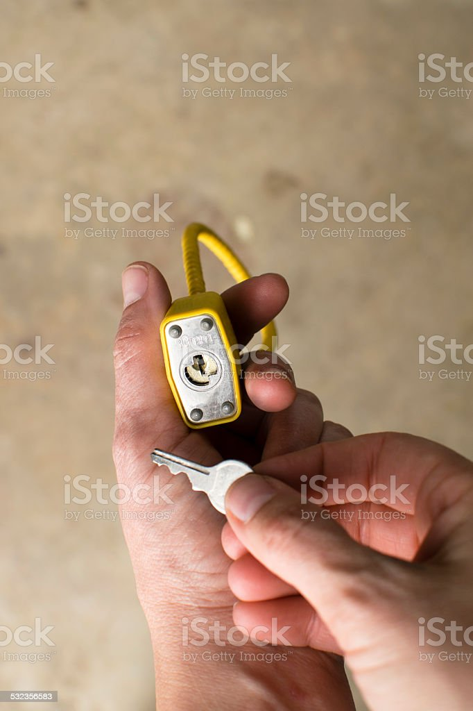 Hands Holding Lock and Key stock photo