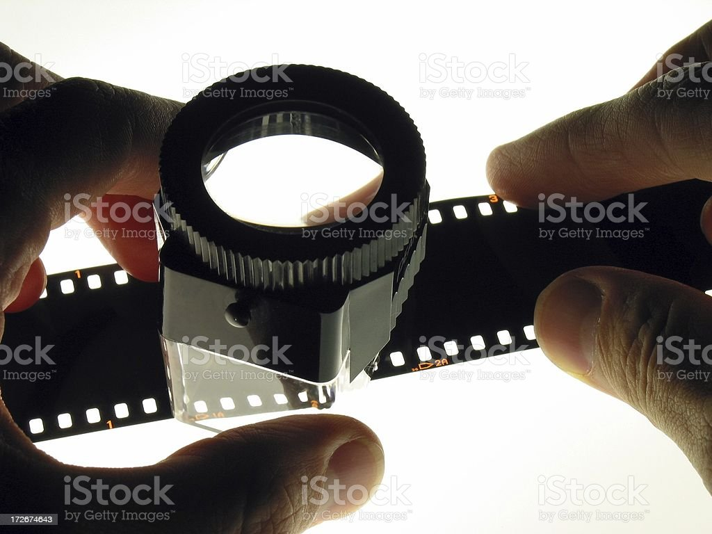 Hands holding loupe stock photo