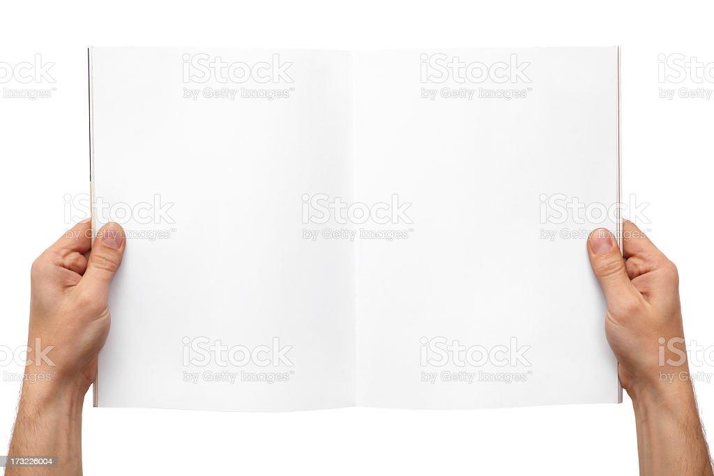 Hands holding magazine stock photo