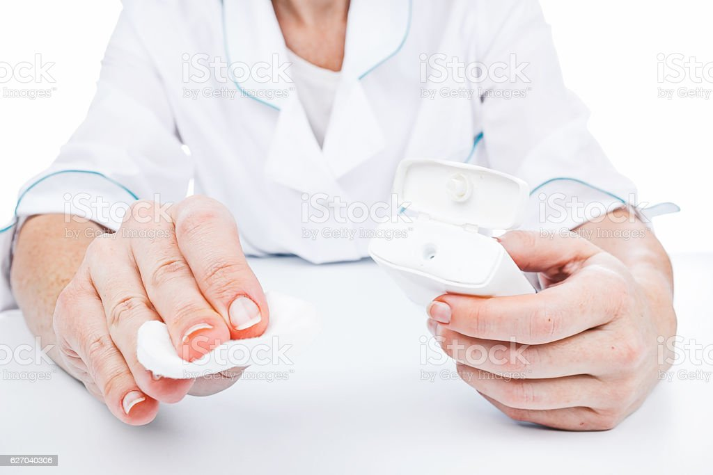 Hands holding makeup remover stock photo
