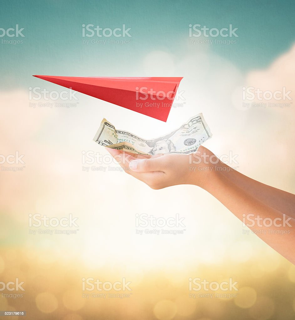 Hands holding money for travel payment stock photo