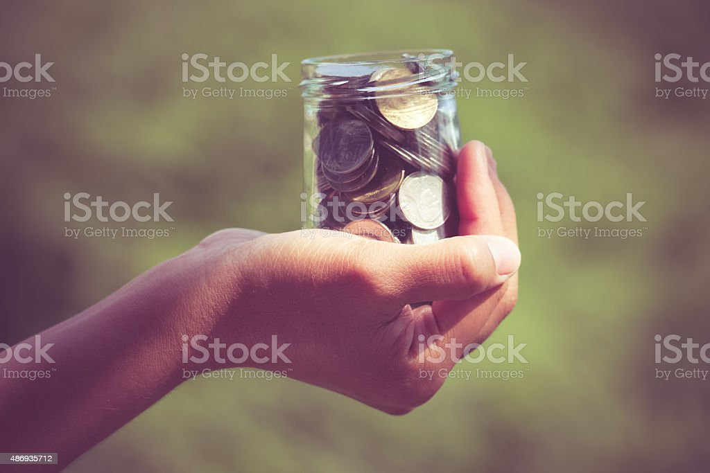 Hands holding money with filter effect retro vintage style stock photo