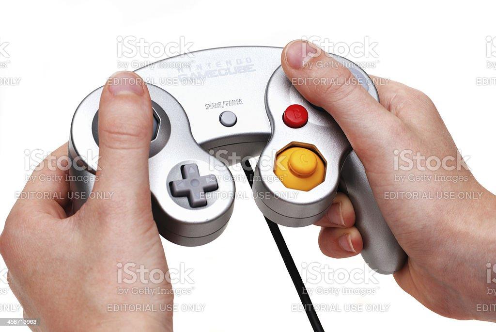 Hands holding Nintendo Gamecube controller handset stock photo