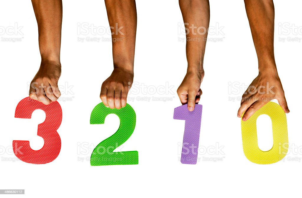 Hands holding numbers 3,2,1,0 stock photo