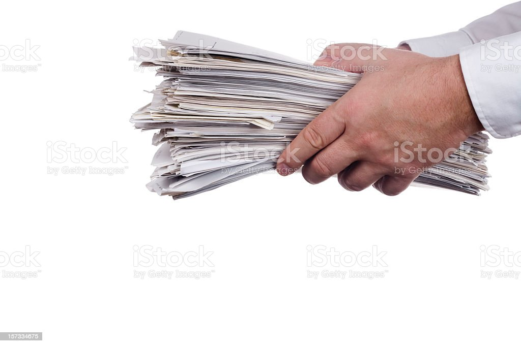 Hands holding out a stack of papers on white background royalty-free stock photo