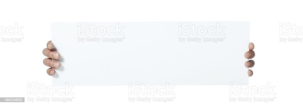 Hands holding paper isolated on white royalty-free stock photo