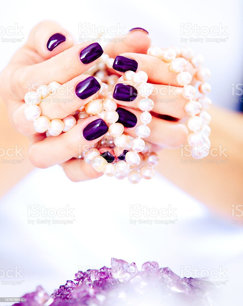 Hands holding pearl necklace royalty-free stock photo