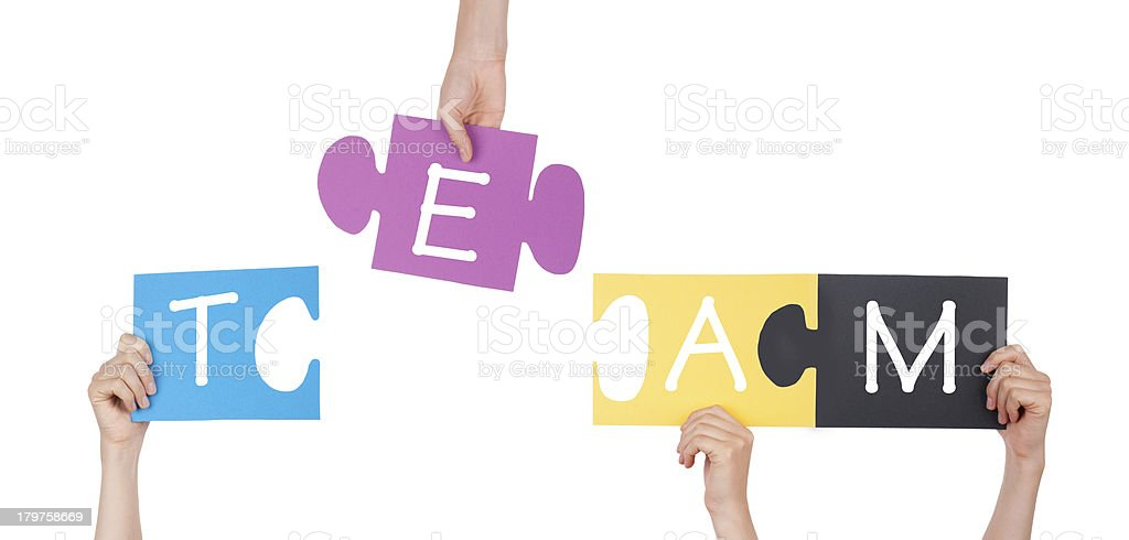 Hands Holding Puzzle with Team royalty-free stock photo