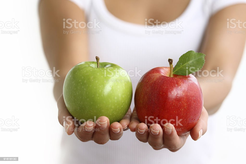 Hands holding red and green apples stock photo