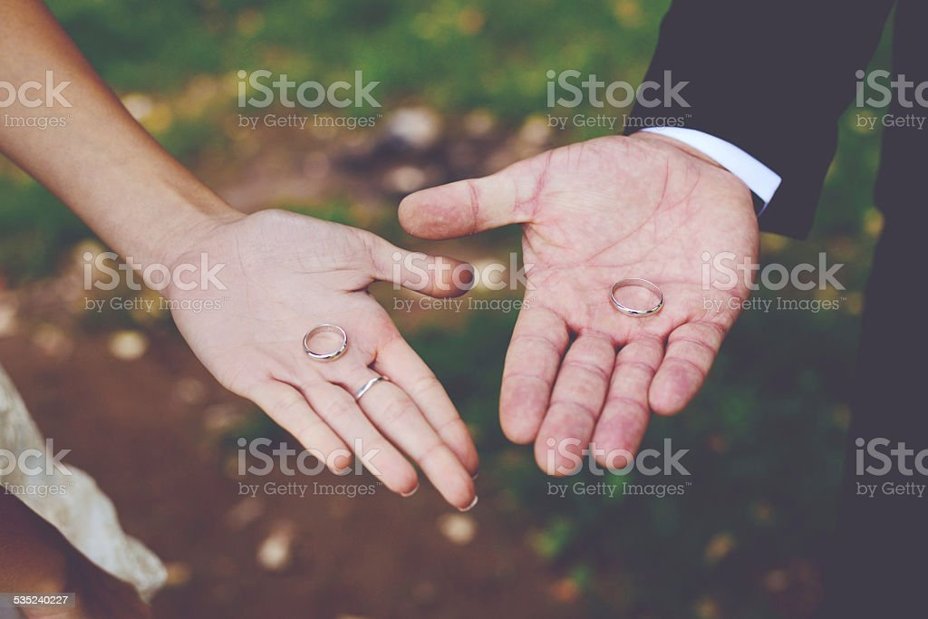 Hands holding rings stock photo