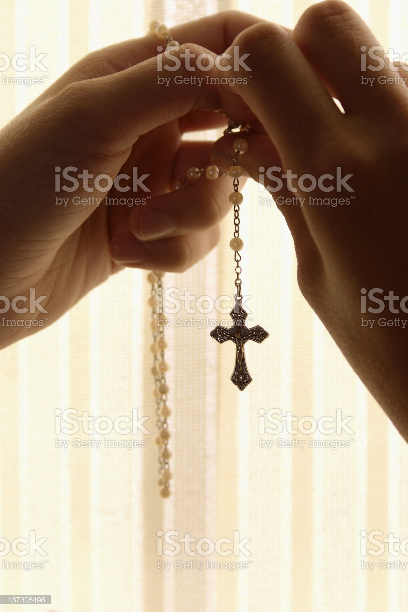 Hands Holding Rosary in Confessional Booth royalty-free stock photo