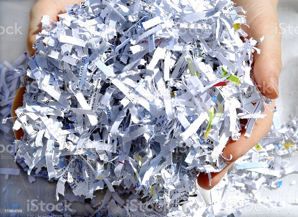 Hands holding shredded paper stock photo