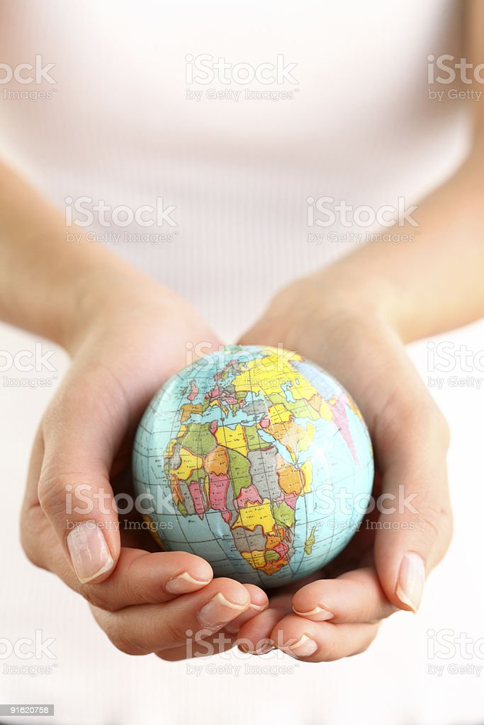 Hands holding small globe royalty-free stock photo