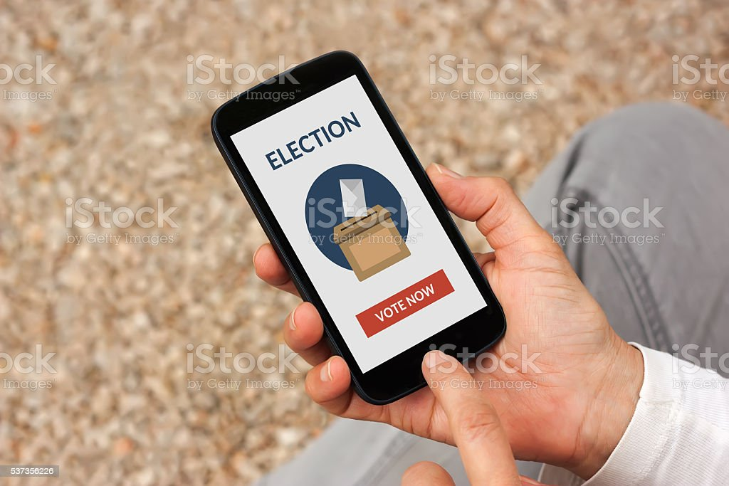 Hands holding smart phone with online voting concept on screen stock photo