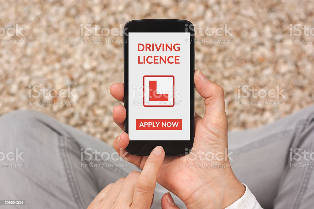 Hands holding smartphone with driving licence application mockup on screen stock photo
