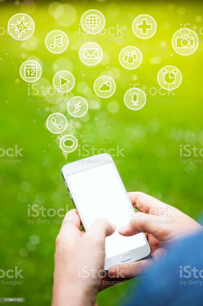 Hands Holding Smartphone with Mobiel App Icons stock photo