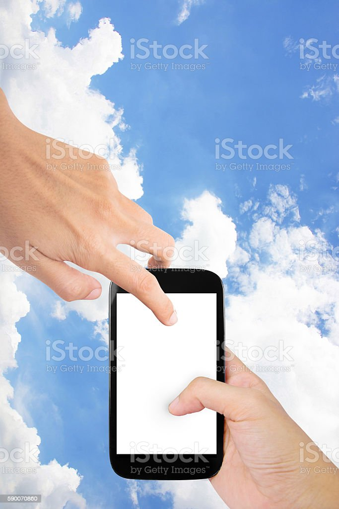 Hands holding smartphones with sky background stock photo