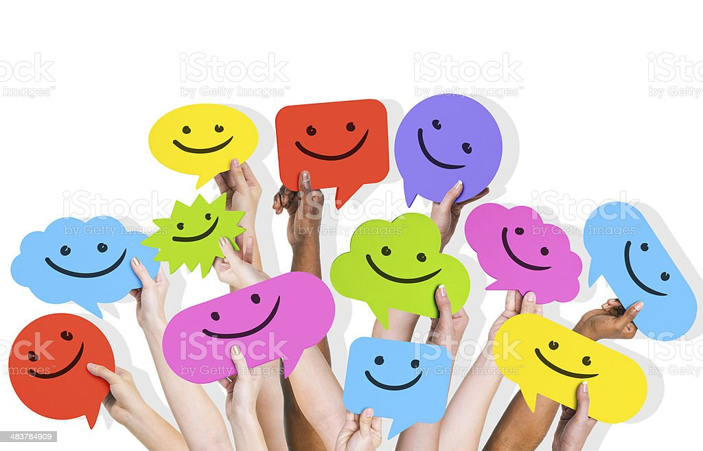 Hands Holding Smiley Face Icons stock photo