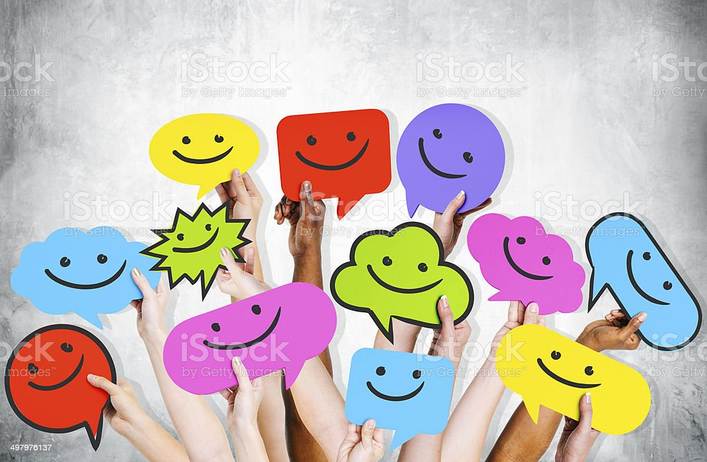 Hands Holding Smiley Faces Icons stock photo