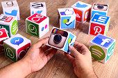 Hands holding social media icons instagram
