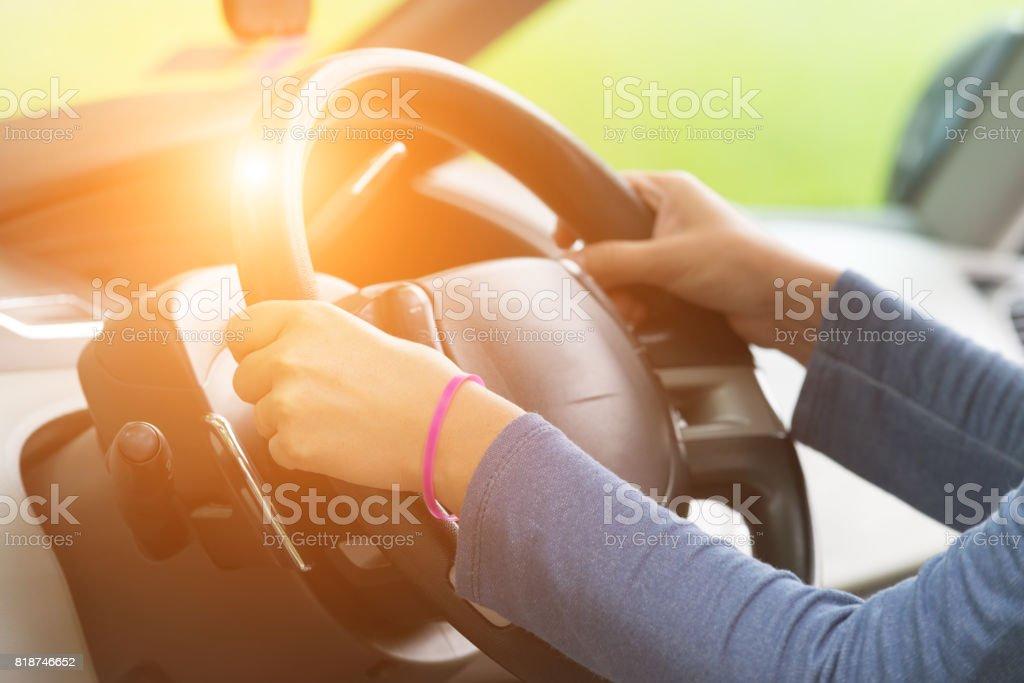 Hands holding steering wheel stock photo