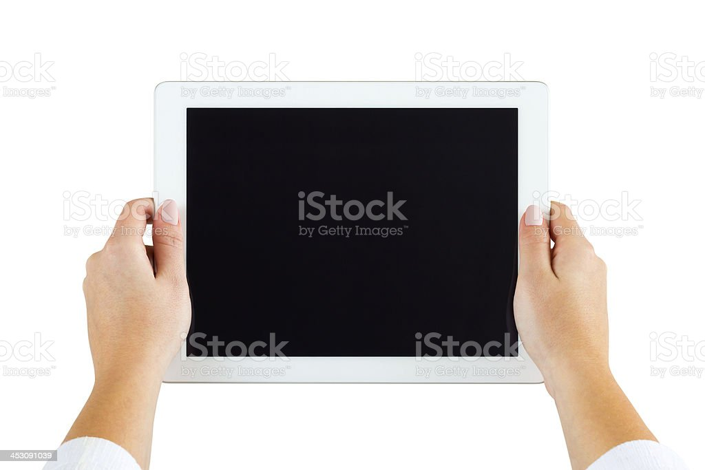 Hands holding tablet stock photo