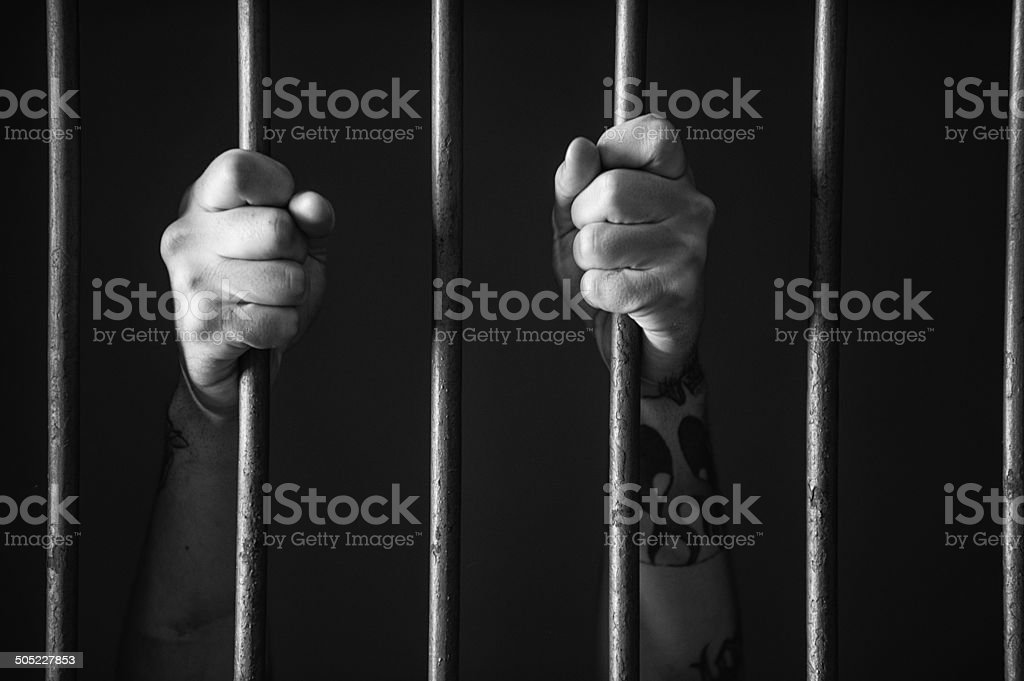 Hands holding the bars stock photo