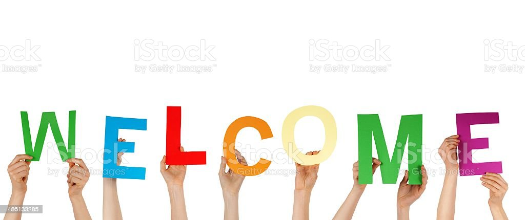 Hands Holding the Letters Welcome, Isolated stock photo