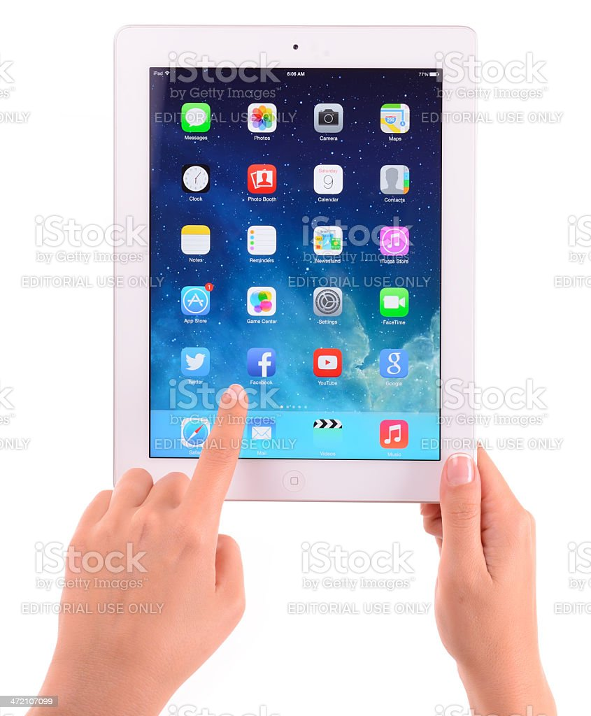 Hands holding The New iPad on white background stock photo