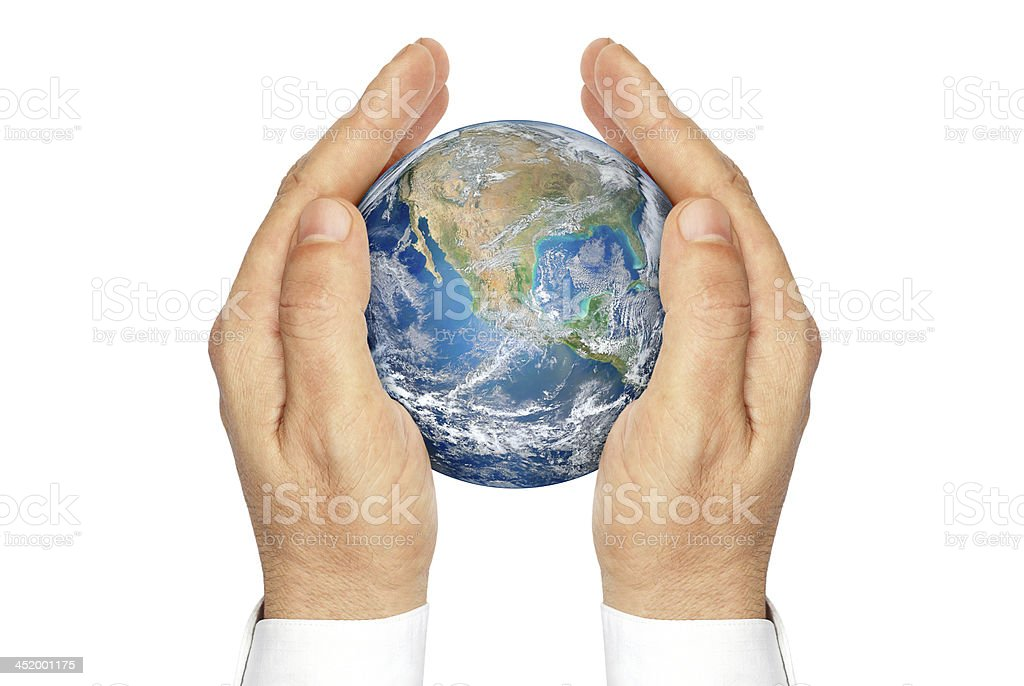 Hands holding the planet Earth isolated on a white background. stock photo