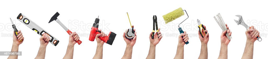 Hands holding tools stock photo